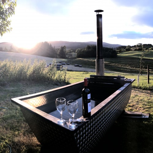 Wood Fired Hot tub (for pods only) Unwind in natural spring water - no chemicalsat Glenshee Glamping